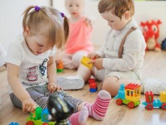 kids-in-playroom-on-floor_23-2147663829